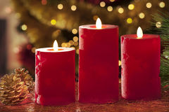 Electric candles with christmas decorations in atmospheric light Stock Photography