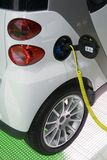 Electric car. Ecologic electric car.Charging operation stock photography