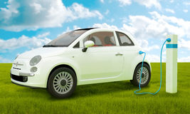 Electric car. Charging to energy column on green meadow Royalty Free Stock Photography