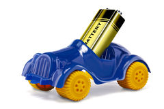 Electric car. Toy car and a battery to simulate an electric car stock images