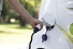 Electric car. Charging of an electric car Royalty Free Stock Photography
