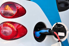 Electric Car. Being recharged on a service station Royalty Free Stock Photo