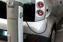Electric Car. Being charged at a charging station Royalty Free Stock Photos