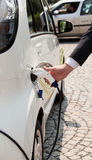 Electric car. Charging of an electric car Royalty Free Stock Image