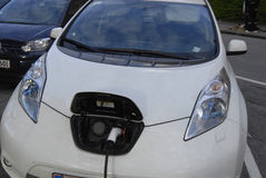 ELECTRIC CAR IS BEING CHARGE. Copenhagen /Denamrk _07 May 2015_    Electric car is being recharge at E- on chagre station electric car production wants state tax Stock Photos