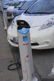 ELECTRIC CAR IS BEING CHARGE. Copenhagen /Denamrk _07 May 2015_    Electric car is being recharge at E- on chagre station electric car production wants state tax Royalty Free Stock Images