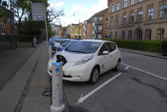 ELECTRIC CAR IS BEING CHARGE. Copenhagen /Denamrk _07 May 2015_    Electric car is being recharge at E- on chagre station electric car production wants state tax Royalty Free Stock Photo