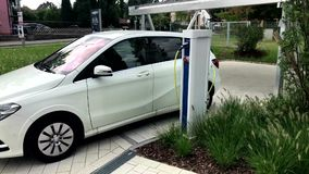 Electric car being charged stock footage
