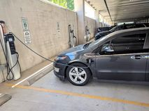 Charging a car Stock Images