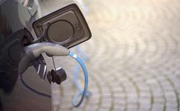 Electric car being charged. Horizontal image with copy space. Electric car being charged. Horizontal image with bokeh background and copy space stock photography