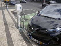 Electric car being charged at public charging point Royalty Free Stock Photos