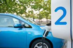 Electric car being recharged on a service station Stock Photography