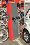 Electric car and bikes Royalty Free Stock Photo