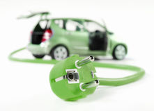 Electric car with cable and plug. All in green color and isolated on white stock image