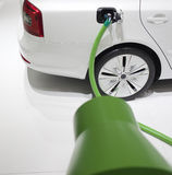 An electric car in charge with green cable Stock Photography