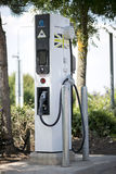 Electric car charger. Electric car charging station for zero emissions and green future to save our planet Royalty Free Stock Photo