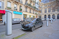 Electric car charges in Paris Stock Image