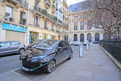 Electric car charges in Paris Stock Photo