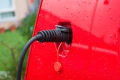 Electric car charging Royalty Free Stock Photos