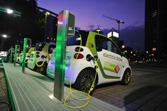 Electric green cars charging Stock Photo