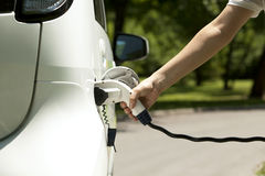 Electric car. Charging of an electric car Royalty Free Stock Photo