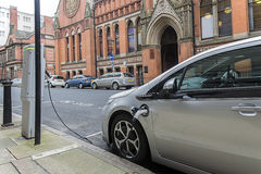 Electric car charging at battery filling station Royalty Free Stock Photography