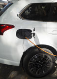 Electric car charging battery Royalty Free Stock Images