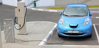 Electric Car Charging. Battery on service station stock photos