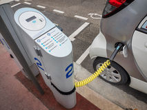 Electric car charging Royalty Free Stock Photography