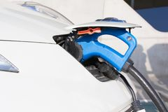 Electric car charging on charge station. Electromobility env royalty free stock photos