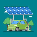 Electric car charging at the charger station in front of solar panels. Stock Images