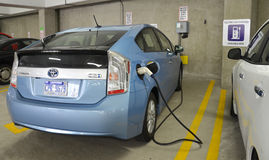 Electric car charging at charging station Royalty Free Stock Photography