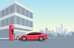 Electric Car Charging at the Charging Station in front of the Of Royalty Free Stock Photo