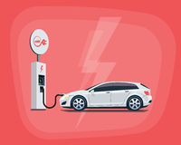 Electric Car Charging at the Charging Station on red background Royalty Free Stock Photos