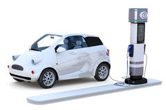 Electric Car Charging. 3D render of a compact electric car charging at a charging station against a white background Royalty Free Stock Photo
