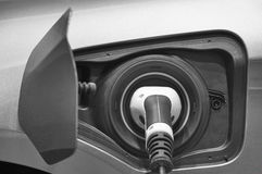 Electric car charging detail. Green and renewable energy technol Royalty Free Stock Photos