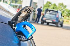 Electric car charging. Ecological automobile royalty free stock photo