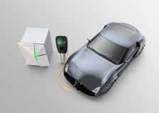 Electric car charging in EV charging station. Stock Images