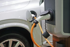 Electric car charging on parking lot. Royalty Free Stock Photography