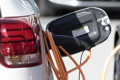 Electric car charging at a electric charging point royalty free stock image