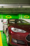 Electric car at a charging point in an underground parking Stock Photography