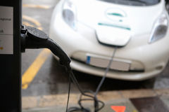 Electric car charging in a public point in Majorca Stock Photo