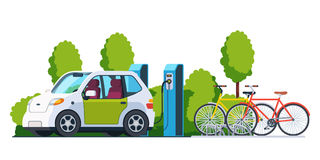 Electric car charging at refuelling power station. Electric car charging outside at refuelling power station. Bikes on a bicycle parking. Modern technology and royalty free illustration