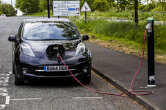 Electric car charging roadside Royalty Free Stock Image