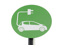 Electric Car Charging Sign. Green sign indicating a charging point for electric vehicles, isolated on white with clipping path Stock Photos