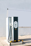 Electric car charging station. New charging station for electric car with a white canvas panel for outdoor advertising Royalty Free Stock Image