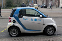 Electric car at a charging station in Amsterdam Royalty Free Stock Image