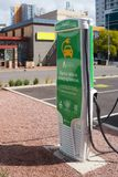 Electric car charging station in city Stock Photo