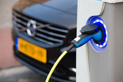 Electric car at charging station Royalty Free Stock Images