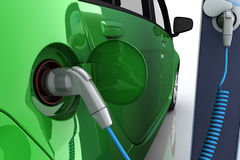Electric car at charging station. Green electric car at charging station with power outlet Stock Images